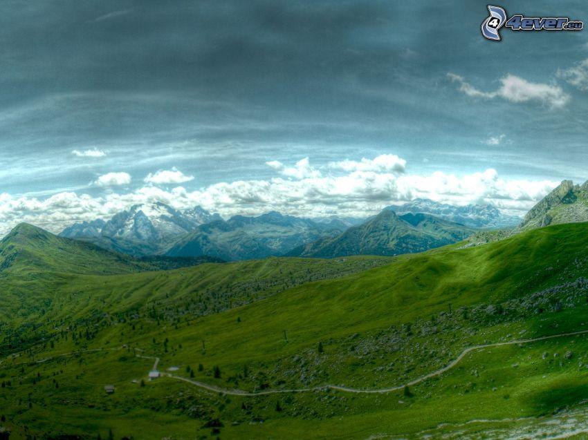 utsikt över landskap, kullar, moln