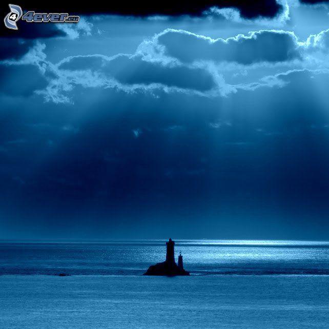 fyr på ö, hav, solstrålar