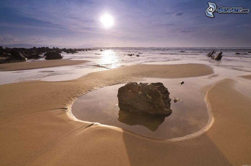 klippor i havet, sandstrand