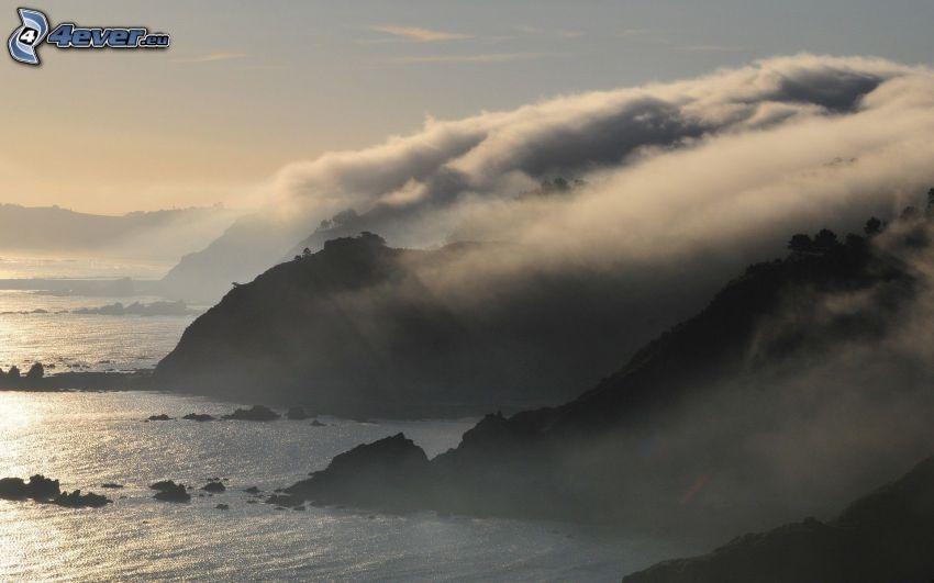 klippor vid kusten, inversion
