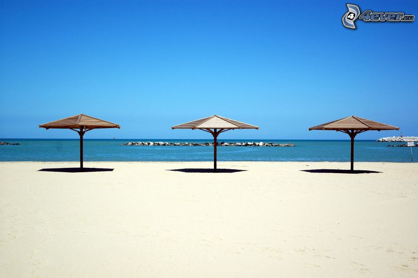 parasoller på strand