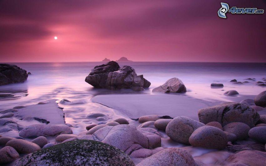 soluppgång, klippor i havet, snö
