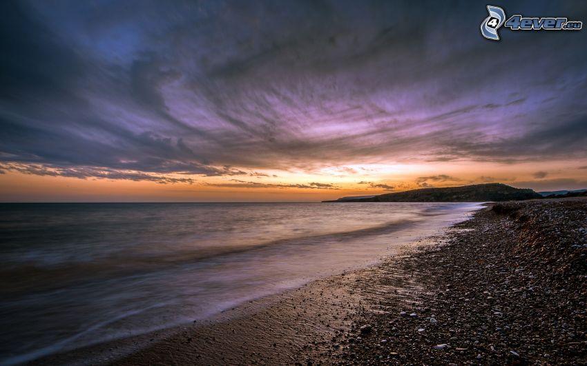 stenig kust, hav, kvällshimmel