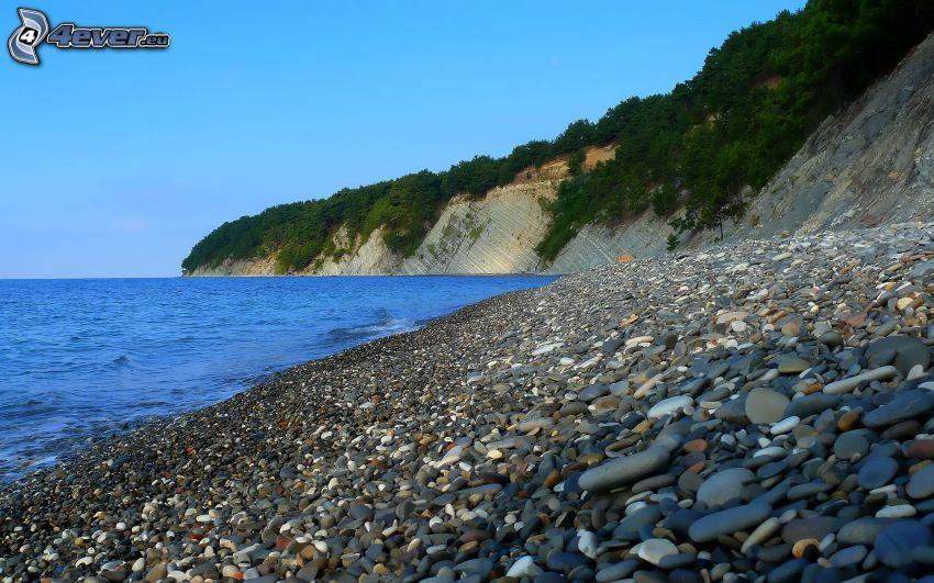 stenig strand, klippor, hav