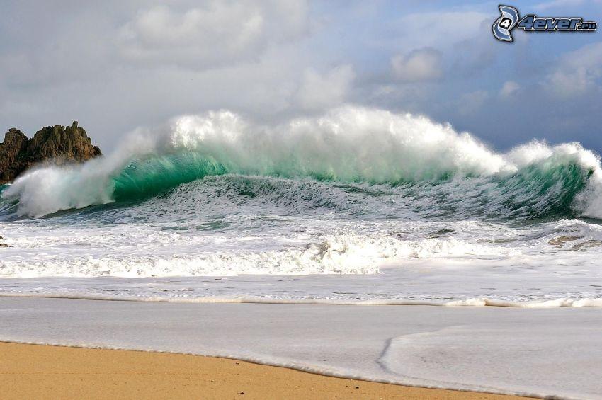 stormigt hav, våg, sandstrand