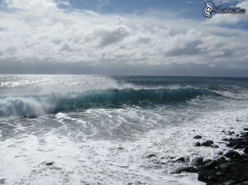 stormigt hav, våg, stenig strand