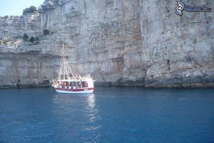 turistbåt, klippor vid kusten, hav