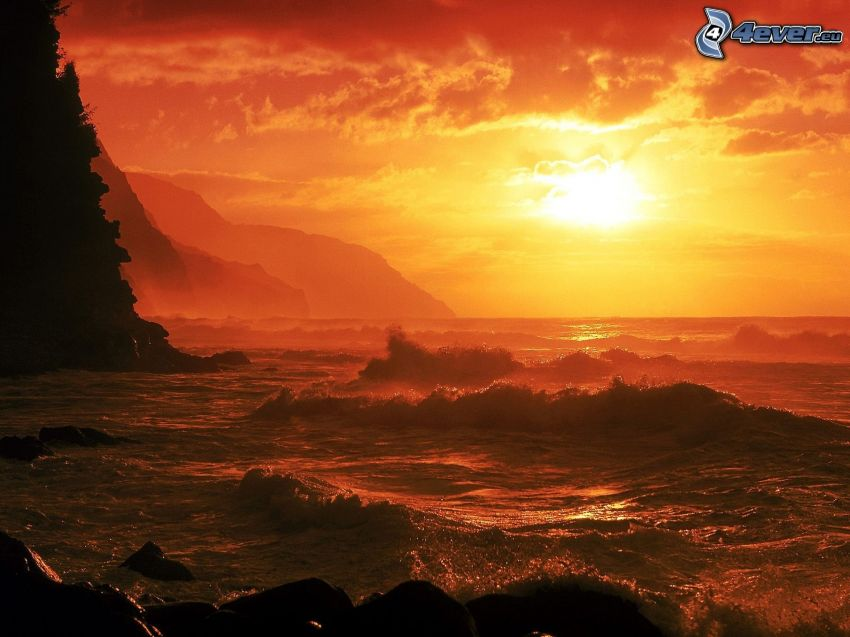 vågor, klippor vid kusten, solnedgång över hav, orange himmel
