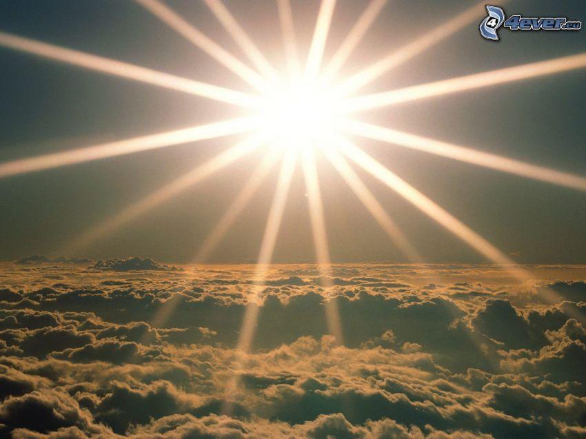 sol, solstrålar, ovanför molnen