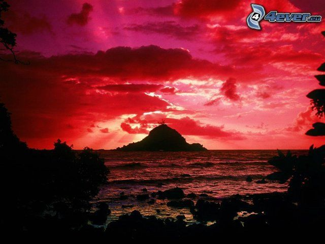 solnedgång bakom ö, röd himmel