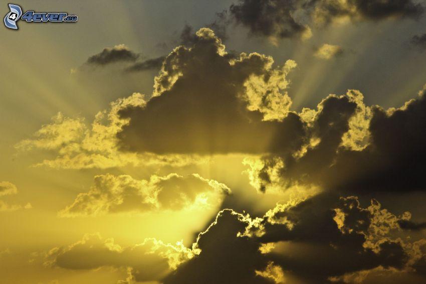 solstrålar, sol bakom molnen