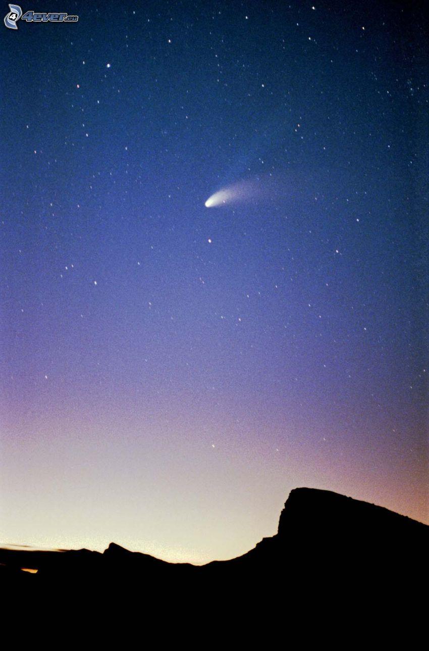 komet, silhuett av horisont, stjärnor