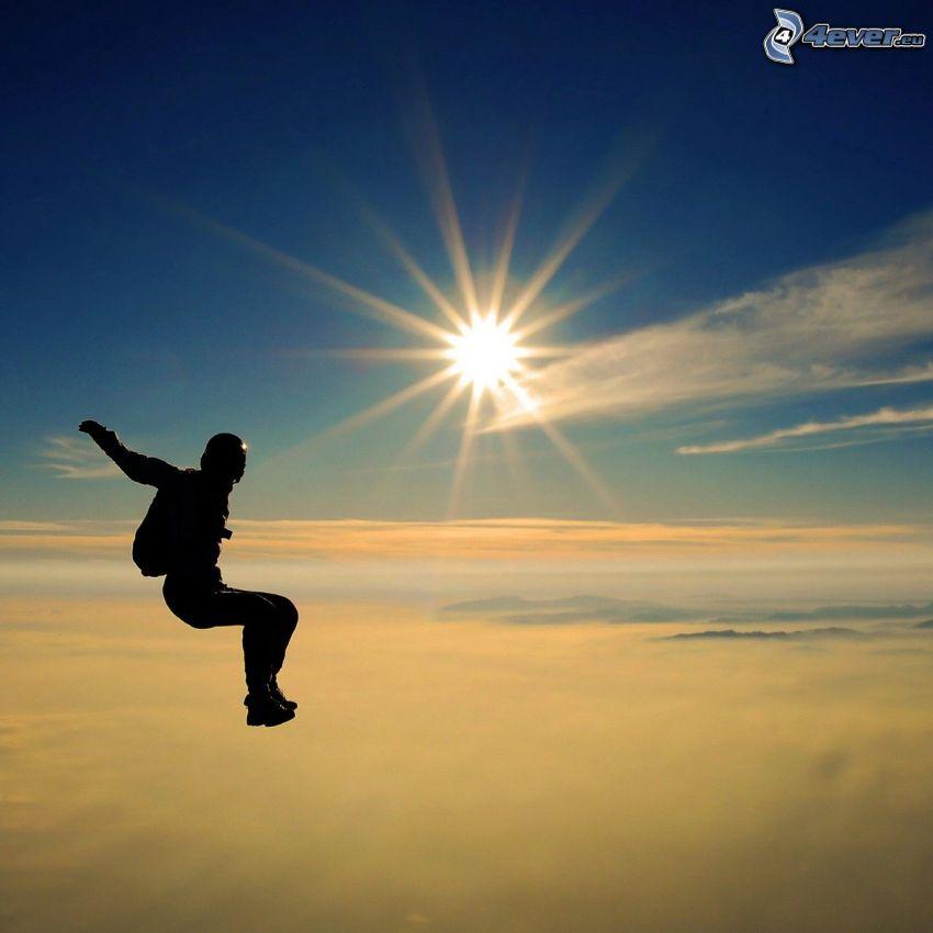 fallskärmshoppare, fritt fall, sol, ovanför molnen