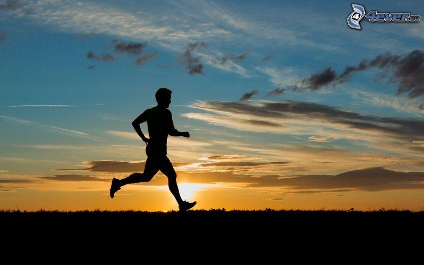 springa, silhuett av man, solnedgång
