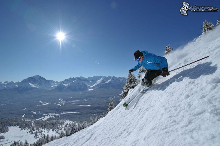 extrem skidåkning, snöklädda berg, sol, utsikt över landskap