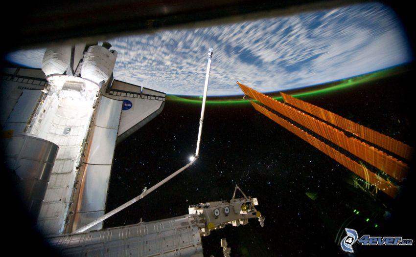 ISS ovanför jorden, raket