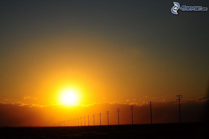 orange solnedgång, elledningar