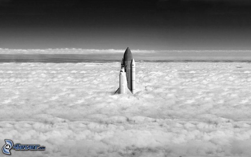 raket, ovanför molnen, svartvitt foto
