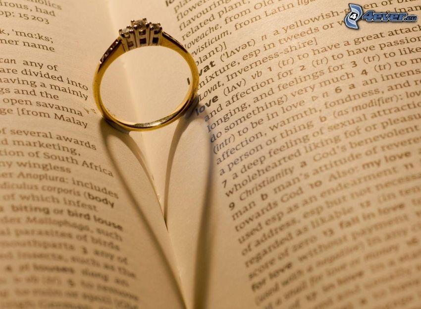 anillo en un libro, sombra, corazón