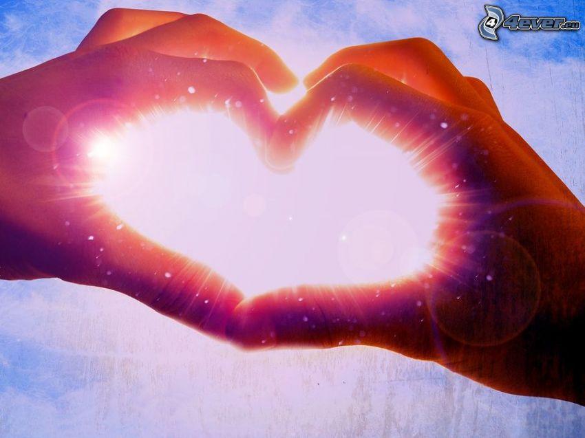corazón de las manos, luz intensa