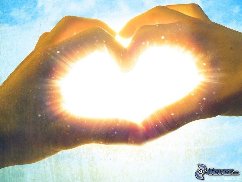 corazón de las manos, sol