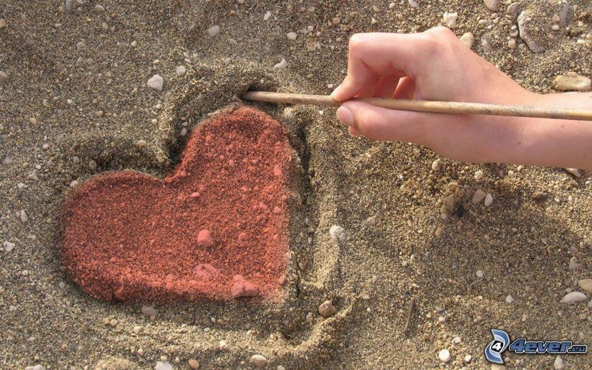 corazón en la arena