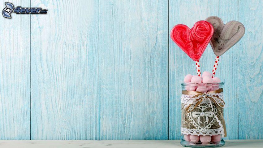 corazones, copa, caramelos, piruletas de colores