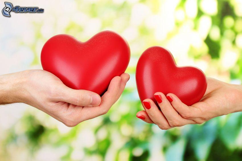 dos corazones, manos