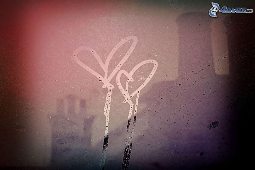dos corazones, rocío en vidrio