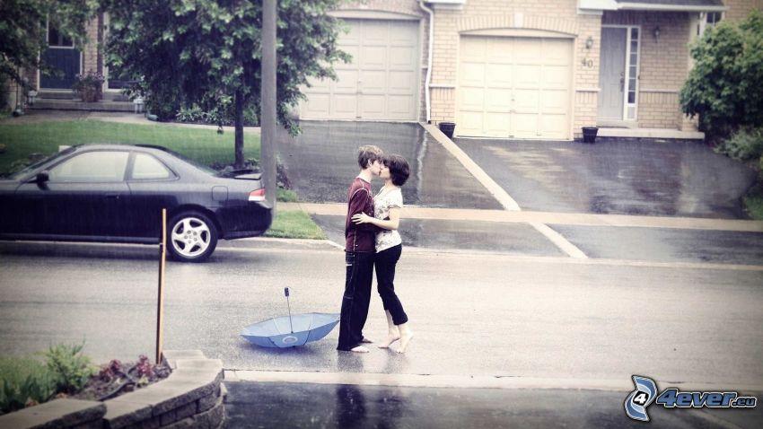 pareja con paraguas, beso bajo la lluvia, calle