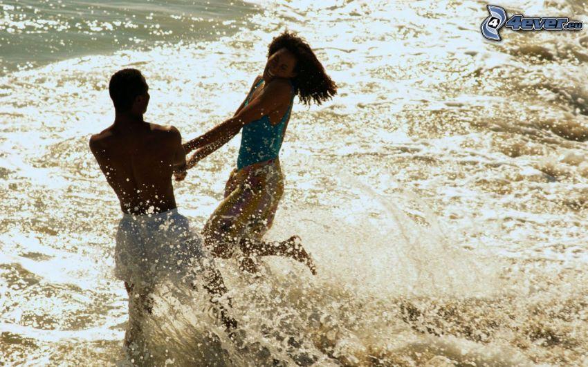 retozar en la playa