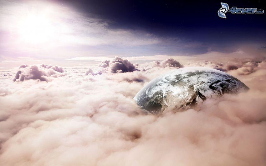 Tierra, encima de las nubes, sol