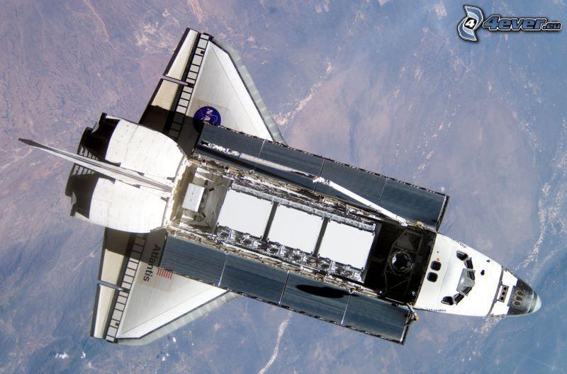 transbordador en órbita, universo