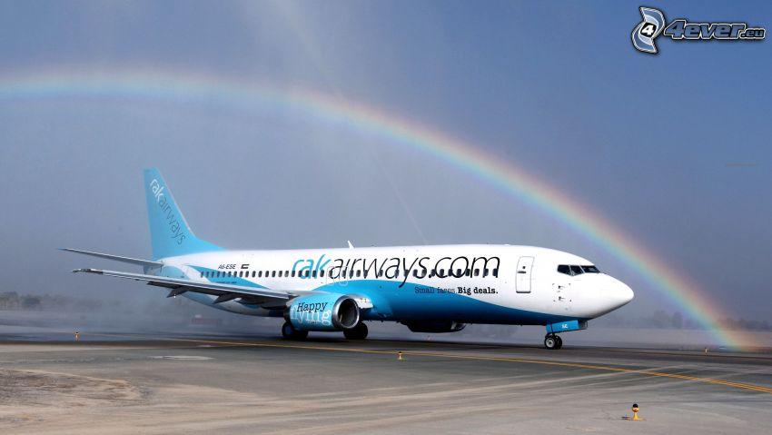 avión, arco iris