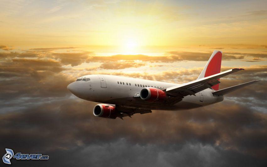 avión, puesta de sol sobre las nubes