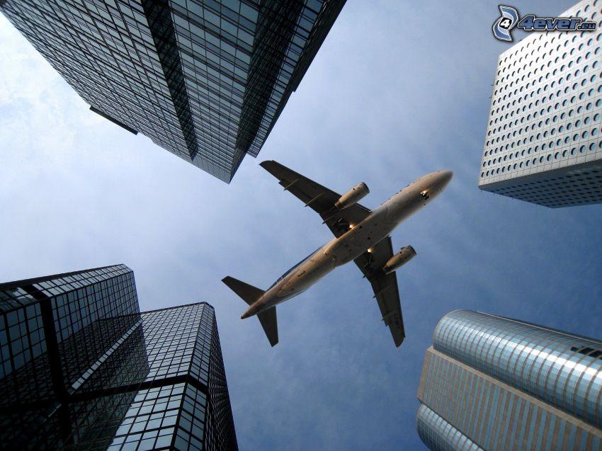 avión, rascacielos