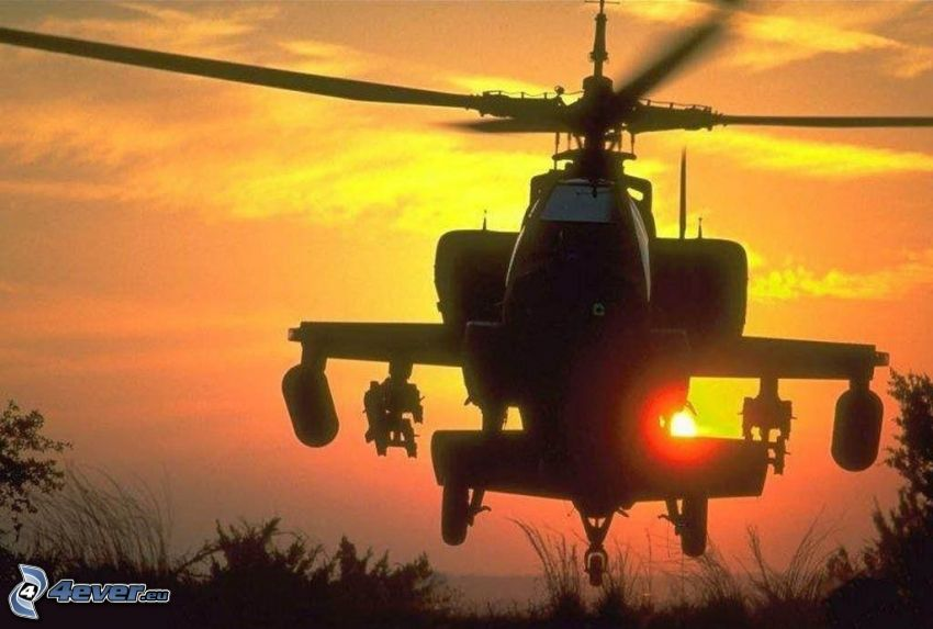silueta del helicóptero, puesta del sol