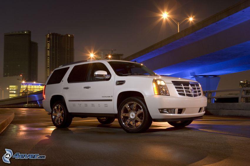 Cadillac Escalade, SUV, atardecer, bajo el puente, iluminación azul, lámparas