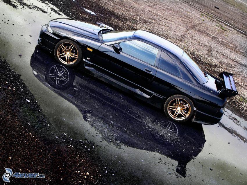 Nissan Skyline GT-R, charco