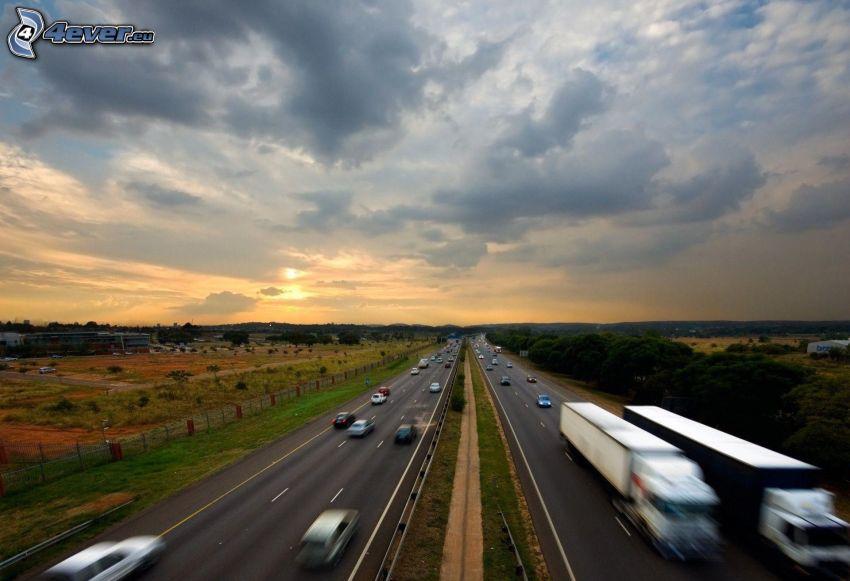 carretera, coches, acelerar, puesta del sol