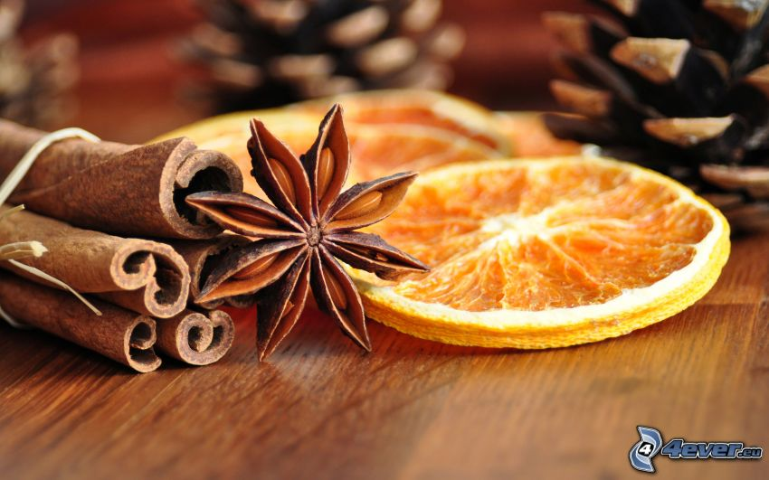 canela, naranjas secas, conos