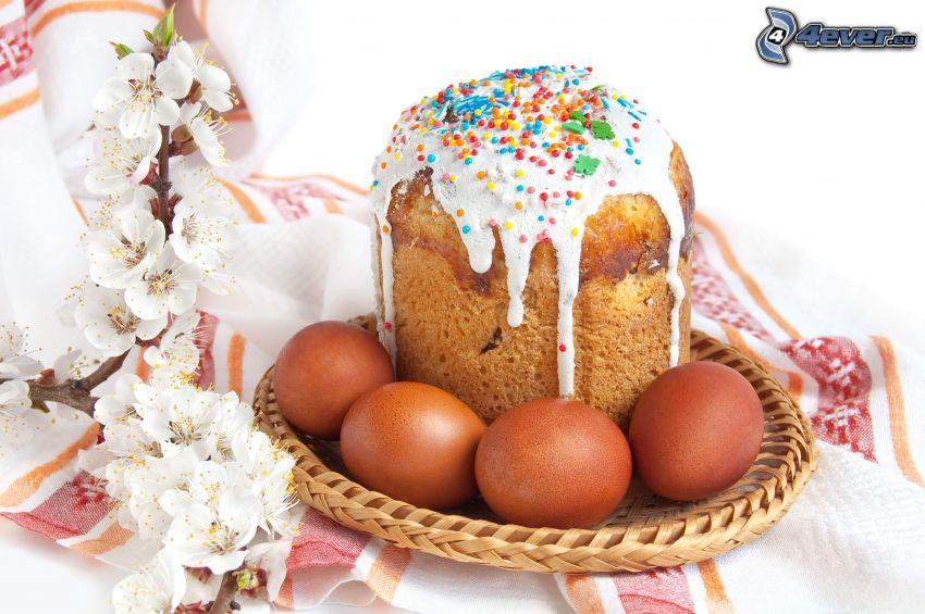 galleta, huevos, rama en flor