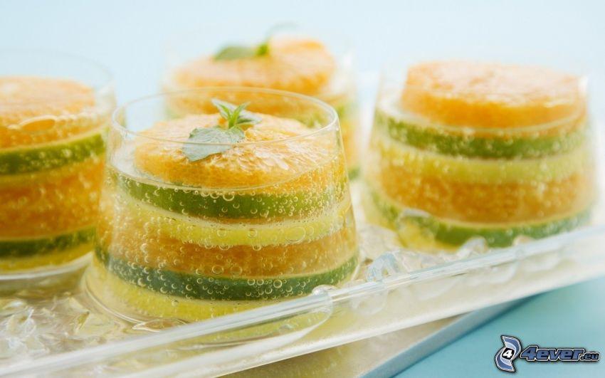 gelatina, rodajas de limón, rodaja de limeta, naranjas en rodajas