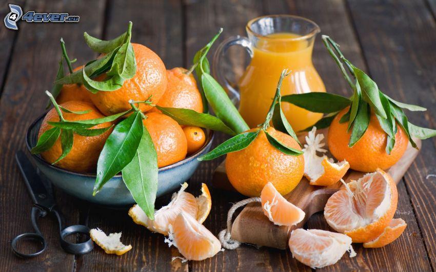 jugo fresco, tangerinas, tijeras