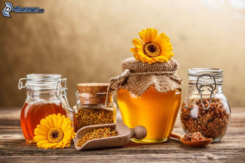 miel, muesli, flores amarillas