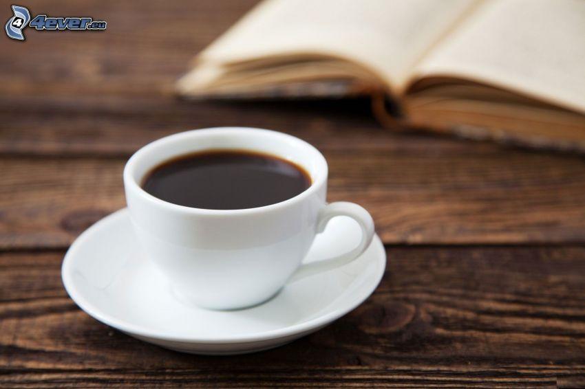 taza de café, libro
