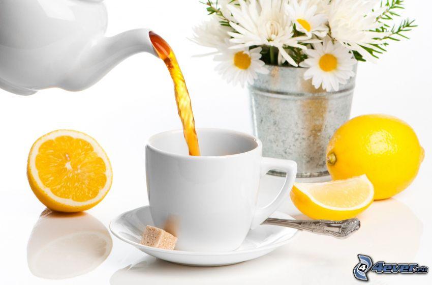 taza de té, limón, manzanilla