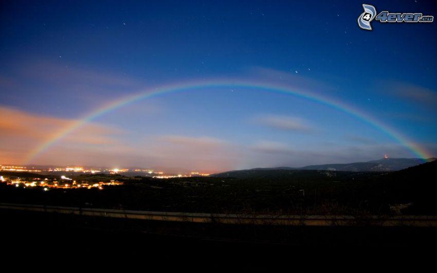 ciudad de noche, arco iris, sierra