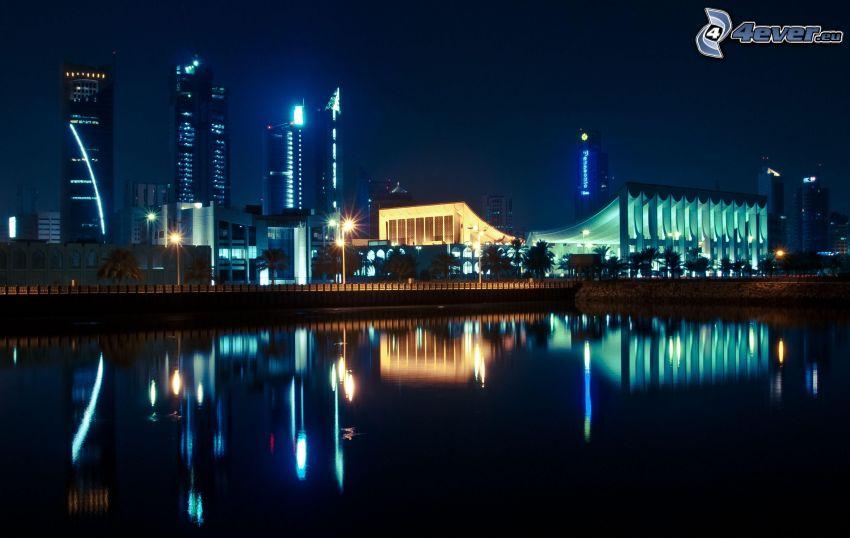 ciudad de noche, río