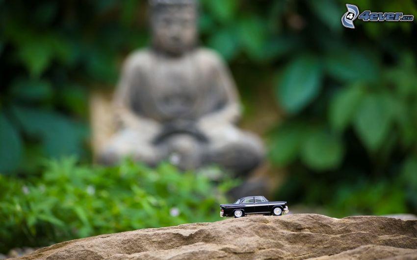 coche juguete, Buda